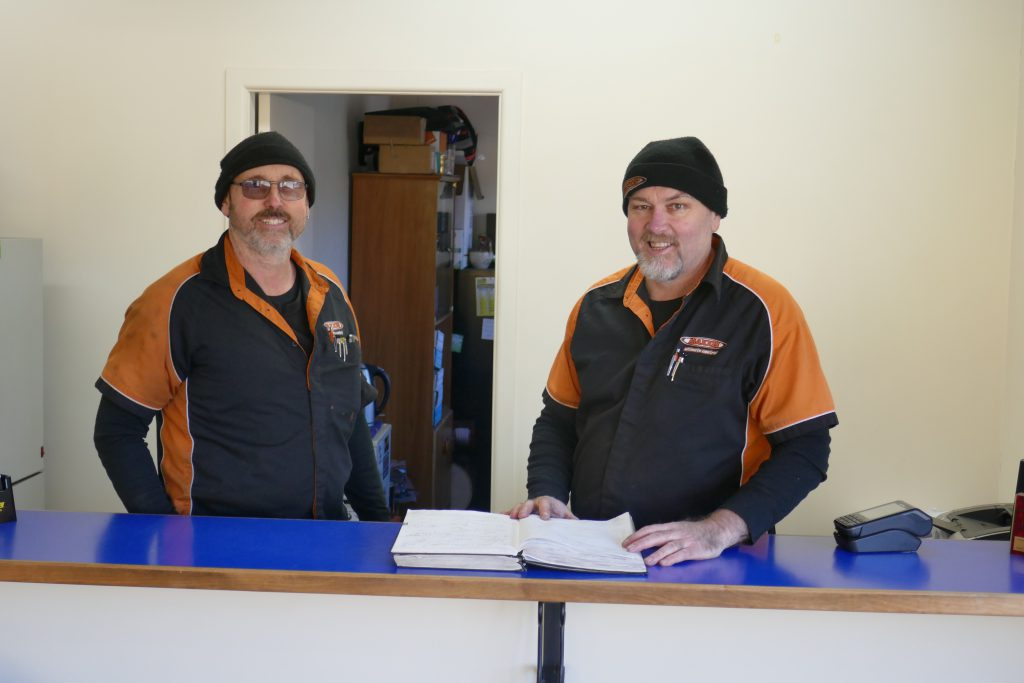 Dave and Paul behind counter